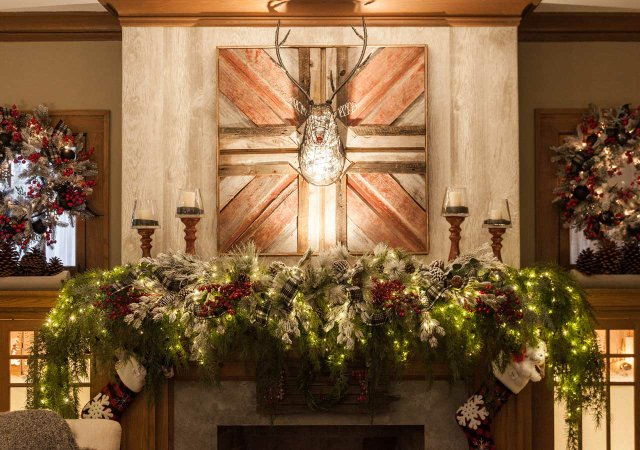 Fireplace mantel decorated for the holidays