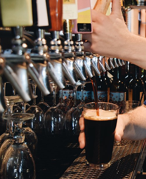 dark beer being poured