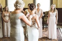 Mother of the bride tending to the bride