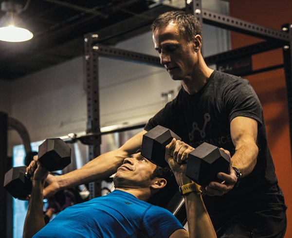 Performance Run Gym guides runners on strength training.