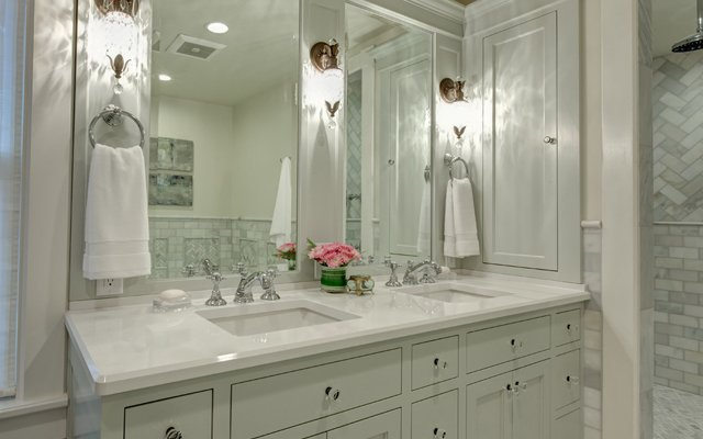 The master bath, designed by Kimberly Herrick, in the 2...
