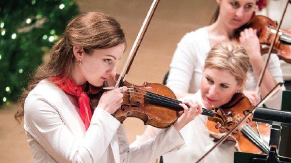 Felicity James Tuning Violin