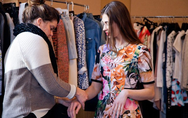 Liz Doyle trying jewelry on model Laura Penton at Mpls....
