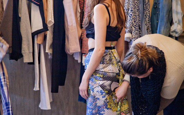 Liz Doyle fitting a skirt on model Laura Penton at Mpls...