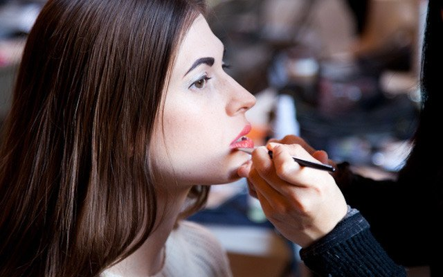 Model, Laura Penton, getting makeup done for Mpls.St.Pa...