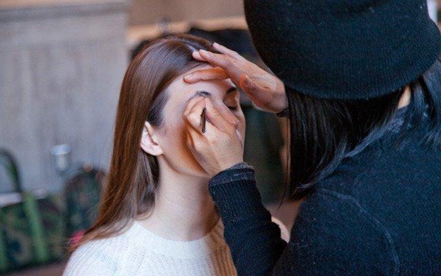Model Laura Penton getting makeup done at Mpls.St.Paul ...
