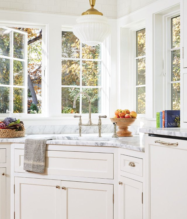 Kitchen with white cabinets and marble countertop