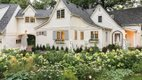 White home with wildflowers in front