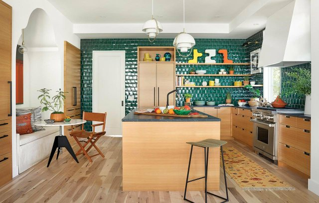 Kitchen with light wood and green tile