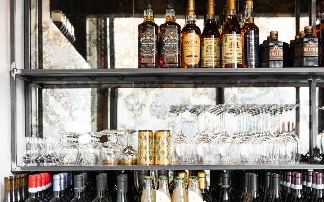 Liquor bottles and glassware at Cobble Social House
