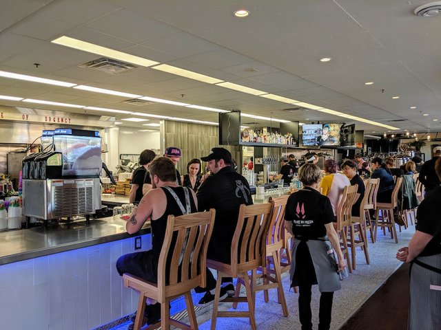 The kitchen bar in the middle of the space