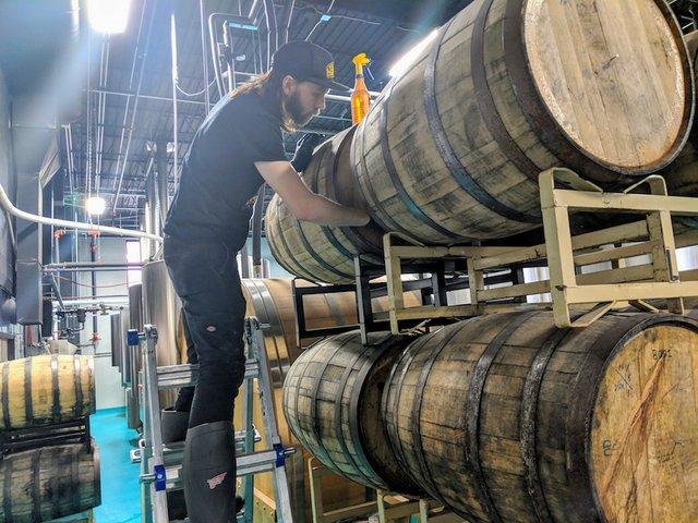 Head brewer Keigan Knee getting a barrel draw