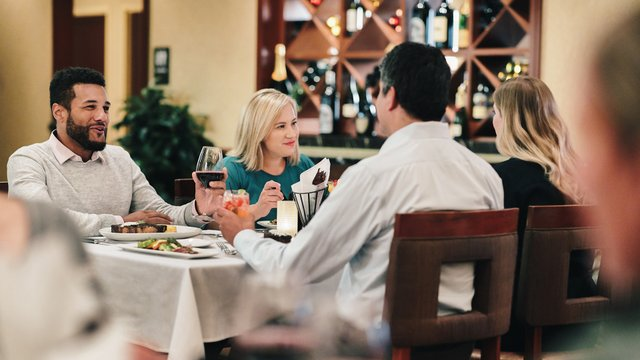 Four people dining at Steakhouse