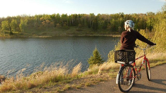 A bicyclist taking in the scenery lake-side
