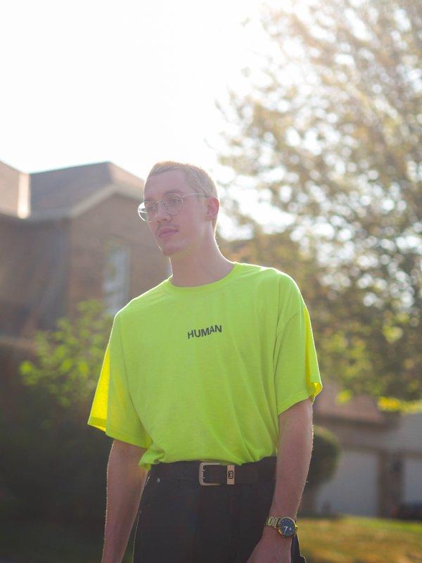 Man wearing a neon yellow t shirt and black pants