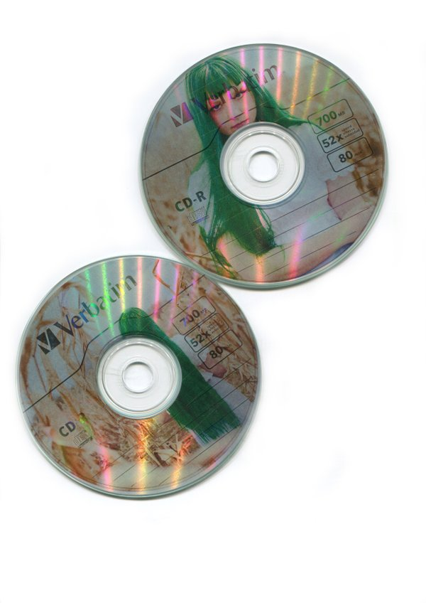 CD's with photos of a girl on them