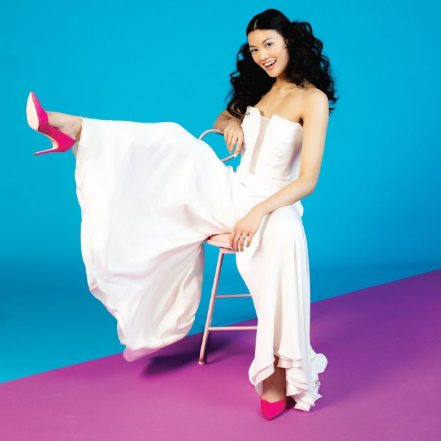 Woman in white jumpsuit with pink pumps
