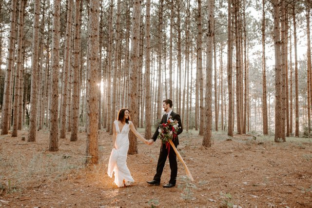 The 11-acre lot at Pinewood has tall pine trees and an outdoor ceremony location.