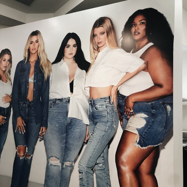 cardboard cut outs of celebrities wearing the jeans