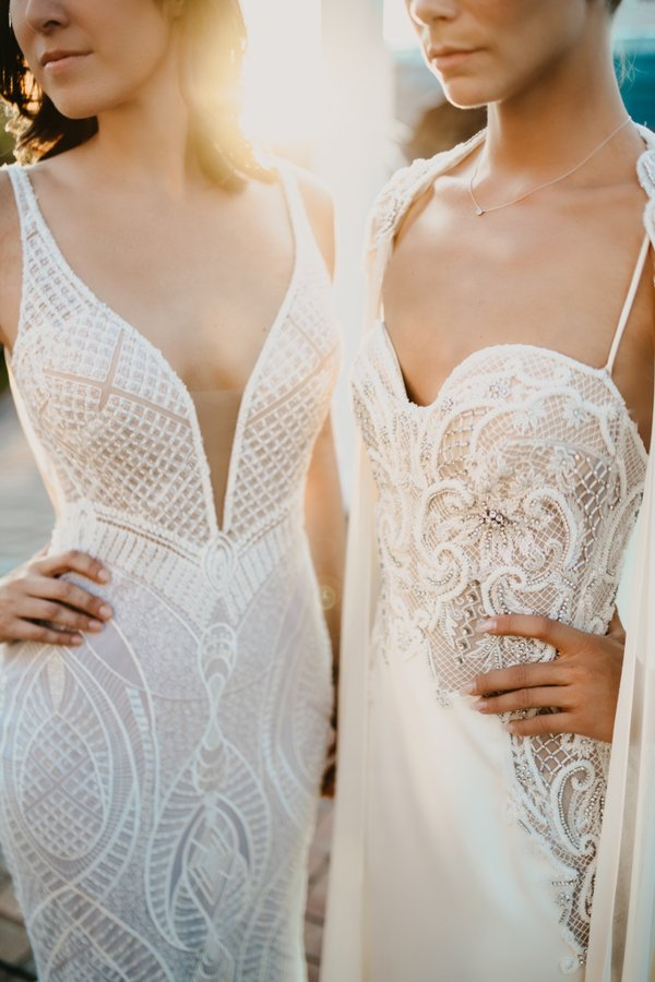 two models both wearing wedding dresses