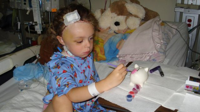 Child in hospital bed painting