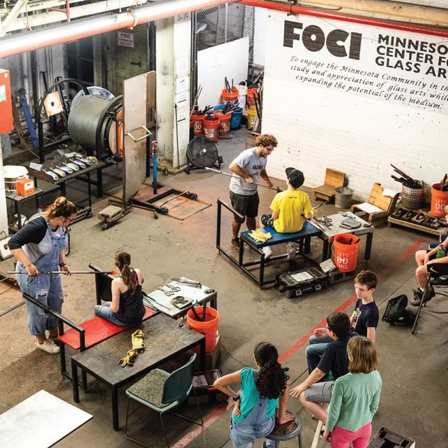 over view shot of a glass blowing class