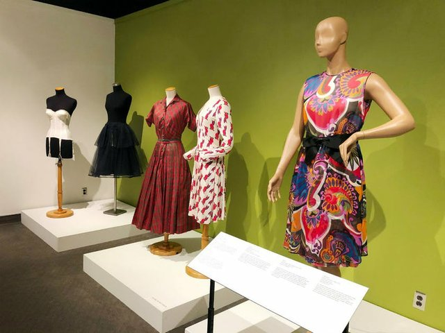 mannequins wearing a few different dresses