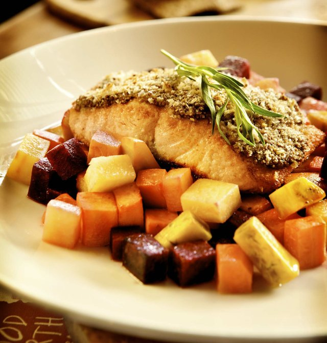 fish on top of beets and potatoes