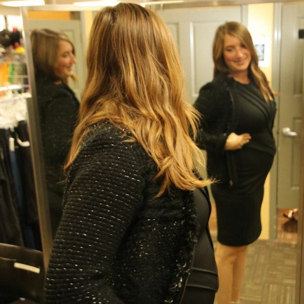 woman in fitting room looking in mirror