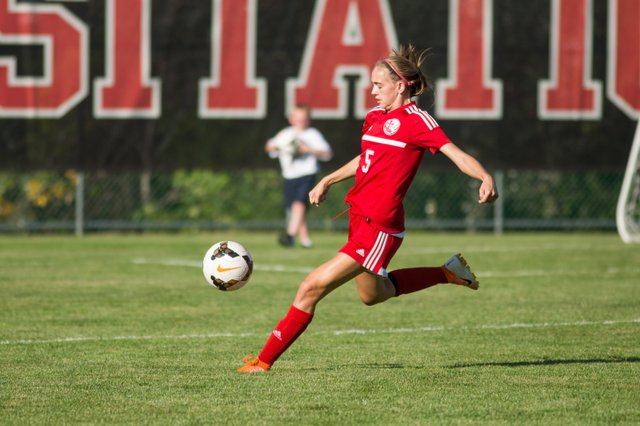 woman soccer player in full stride