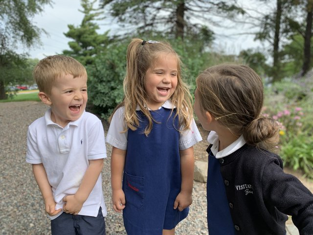 two girls and a boy laughing