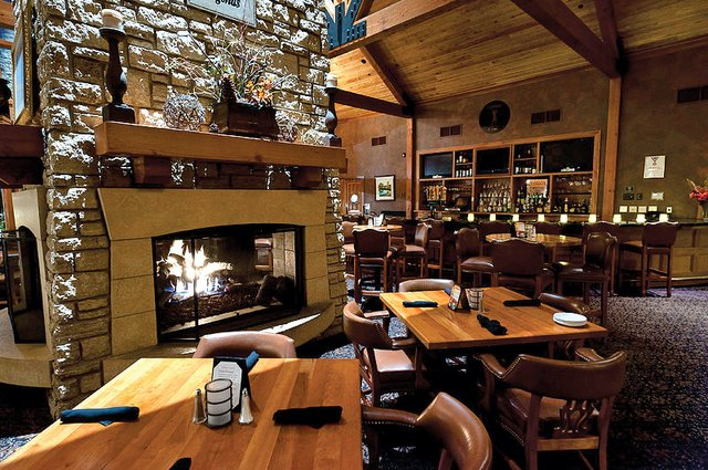 interior of a restaurant with vaulted ceiling and fire place