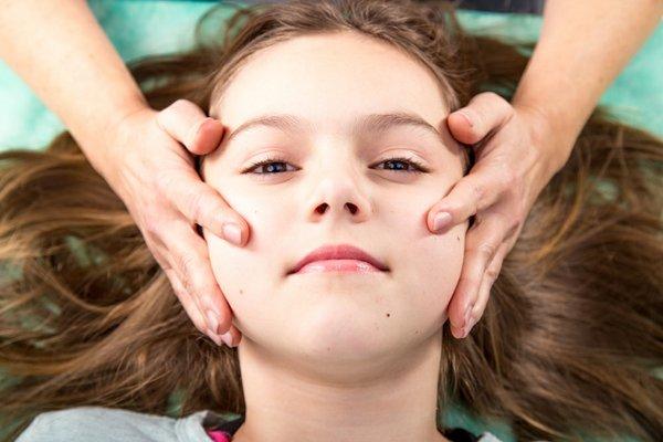 Child receiving craniosacral therapy