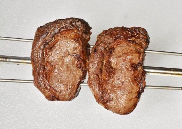 two hunks of meat on skewer
