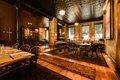 restaurant interior lots of wood and brick