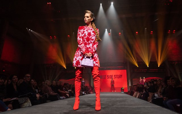 Fashionopolis 2019: woman on runway wearing red and white floral dress and tall red boots