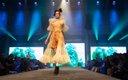 Fashionopolis 2019: woman on runway wearing yellow dress and black shoes