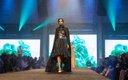 Fashionopolis 2019: woman on runway wearing black and white polka dot dress, bustier and long black jacket