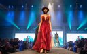 Fashionopolis 2019: woman on runway wearing long red dress and hat