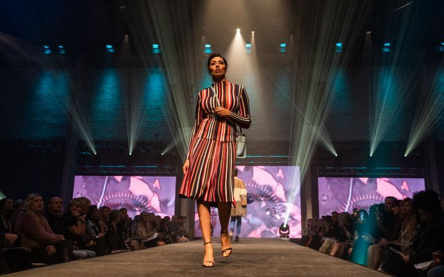 Fashionopolis 2019: woman on runway wearing striped skirt and top