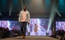 Fashionopolis 2019: man on runway wearing black pants and plaid shirt