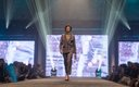 Fashionopolis 2019: woman on runway wearing striped suit with striped turtleneck top