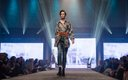 Fashionopolis 2019: woman on runway wearing denim jeans and black and white shirt patterned blouse and jacket