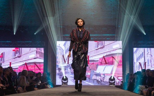 Fashionopolis 2019: woman on runway wearing long black skirt and striped wrap