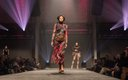 Fashionopolis 2019: woman on runway wearing patterned skirt and turtleneck top