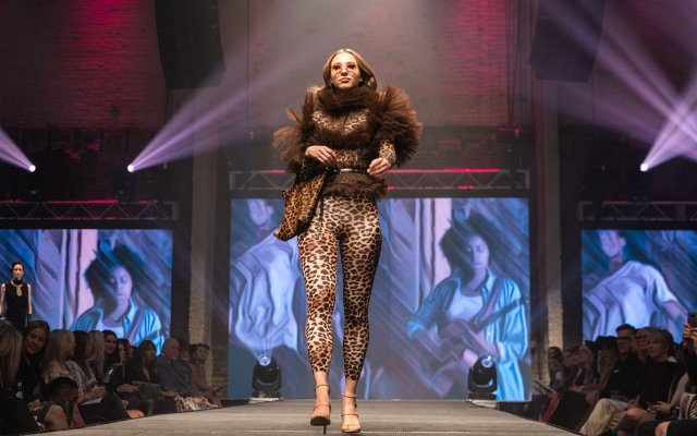 Fashionopolis 2019: woman in leopard print jumpsuit and puffer blouse