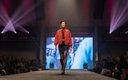 Fashionopolis 2019: woman wearing dress, chain link belt and puffy bomber jacket