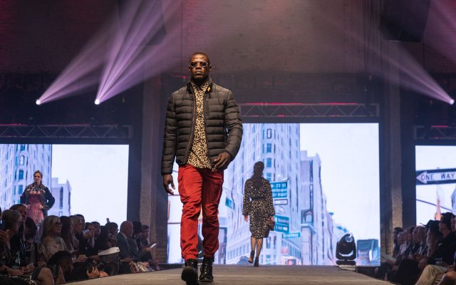 Fashionopolis 2019: man on runway wearing puffer coat, red pants, and leopard print button down
