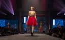 Fashionopolis 2019: woman on runway wearing red tutu skirt, body suit and black leather belt