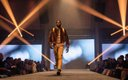 Fashionopolis 2019: man on runway wearing brown jacket, and plaid button down shirt
